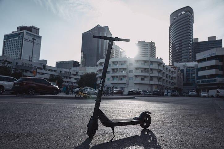 electric scooter demographics, e-scooter with cityscape