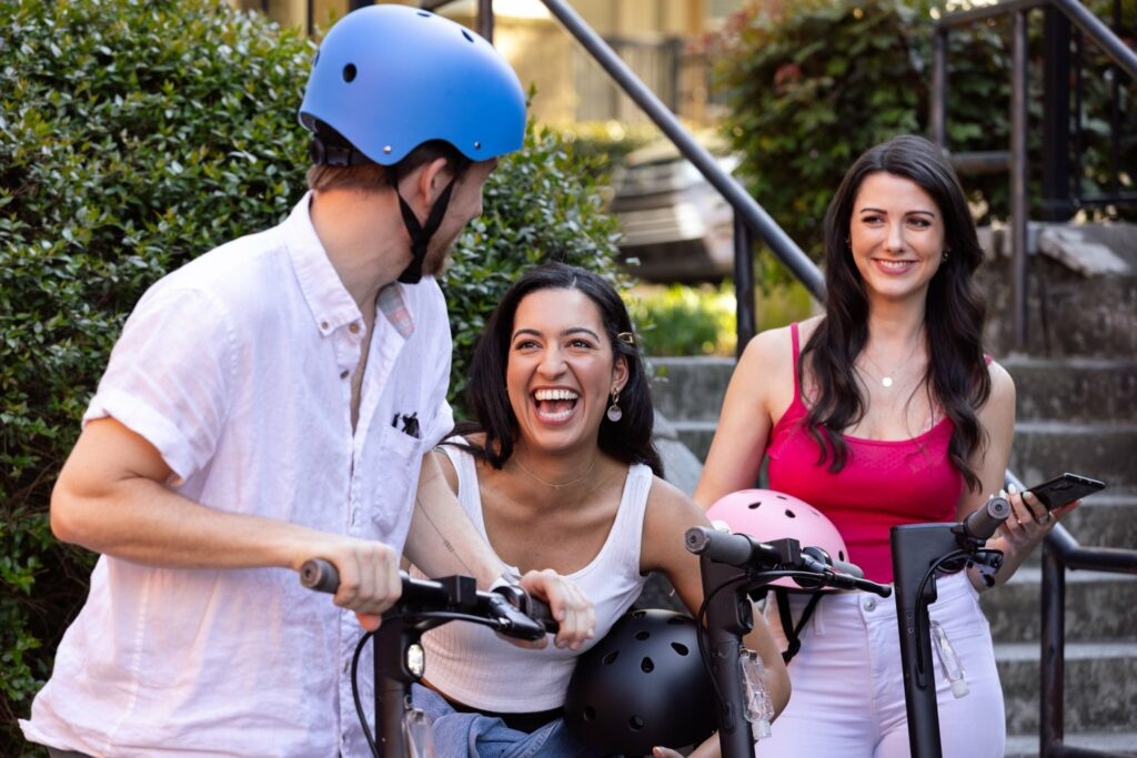 EAST Framework, young people laughing with e-scooters